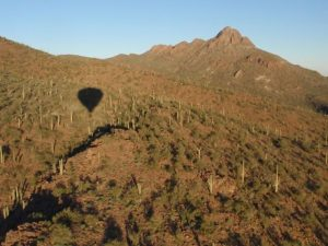 Our shadow preceded us as we flew toward Sombrero Peak.
